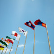 Flags on blue sky — Stock Photo