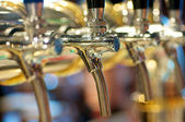 Golden Beer Taps — Stock Photo