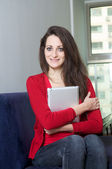 Beautiful girl holding an ipad — Stock Photo