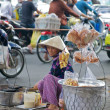 Vietnam street vendor selling snack — Stock Photo