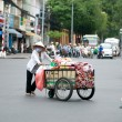 Hawker selling hats - Stockfoto