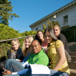 Group of students on stairs — Stock Photo