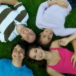 Stock Photo: Friends lying on grass
