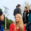 Students talking on campus — Foto Stock