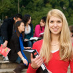 bela estudante sorrindo — Fotografia Stock  #8526173