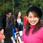 estudante asiática sorrindo — Foto Stock