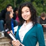estudante asiática com o bloco de notas — Foto Stock