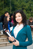 Asian Student with Notepad — Stock Photo