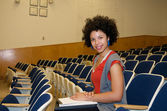 African American student in lecture hall — Stock Photo
