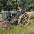 plowing with old tractor — Stock Photo
