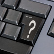 Stock Photo: Question mark on black enter key