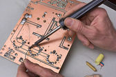 Repair of circuit board — Stockfoto