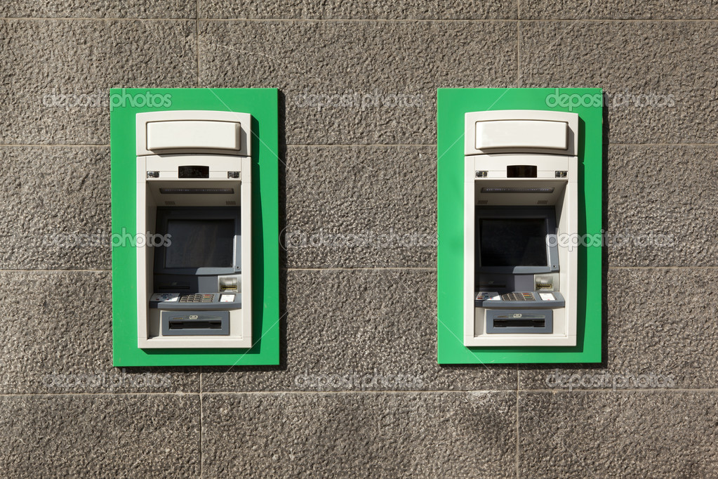 Two ATM's on a stylish stone wall — Stock Photo #9537671