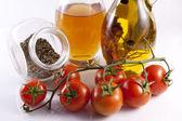 Italian cuisine - oregano and cherry tomatoes — Stock Photo