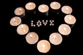 Heart with candles — Stock Photo