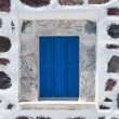 Stoned wall with blue window — Stock Photo