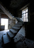 Abandoned room with staircase — Stock Photo