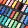 Stock Photo: Used colorful pastels in row