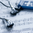 Mp3 player on a music Sheet — Stock Photo