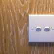 Light Switch on a wooden wall — Stock Photo #9925722