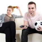 Couple watching football — Stock Photo
