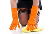 Sexy girl in stockings cleaning floor — Stock Photo