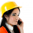 Engineer woman on phone - Stock Photo