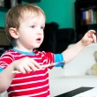 Baby boy with paintbrush — Stock Photo