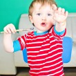 Baby boy with paintbrush — Stock Photo #9112174