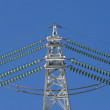 Stock Photo: Electricity pylon before blue sky