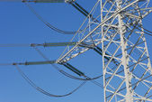Electricity pylon before blue sky — Stock Photo