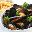 Steamed mussels with white wine, and french fries — Stock Photo #10259088