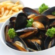 Steamed mussels with white wine, and french fries — Stock Photo