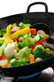 Cook vegetables in a chinese wok — Stock Photo