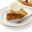Homemade apple pie topped with ice cream — Stock Photo