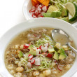 White pozole, mexican soup cuisine - Stock Photo