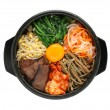 Bibimbap in a heated stone bowl, korean dish — Stock Photo