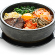 Royalty-Free Stock Photo: Bibimbap in a heated stone bowl, korean dish