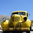 Stock Photo: Yellow abandoned Bonnie and Clyde vehicle