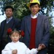 Stock Photo: Little girl with her father and uncle
