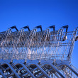 Shopping carts in row outside supermarket — Stock Photo #8377556