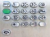Botones de un teléfono en una cabina telefónica — Foto de Stock