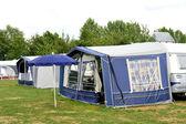Tents and a caravan — Stock Photo