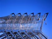 Shopping carts in row outside a supermarket — Stock Photo