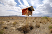 Postbox in the desert — Stock Photo