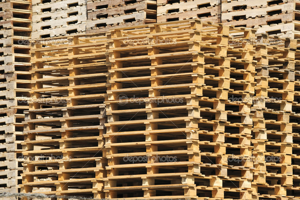 A stack of wooden pallets waiting to be used for transporting products  Stock Photo #8439050