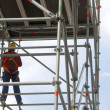 Scaffold and worker — Stock Photo