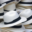 Straw hats with black band - Stock Photo