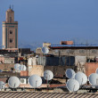 Satellite dishes on roofs - Foto Stock