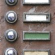 Old apartment buzzers - names removed — Stockfoto #8446817